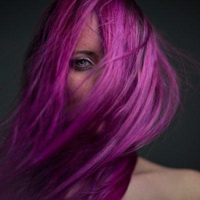 dramatic portrait attractive girl with styling violet hair